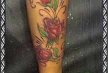 Rose tattoo done by panther tattoos