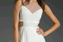 """Style: GRADUATION / This super sexy Style Stalker """"Currency"""" dress featuring a white bustier, white skirt, side cut outs and nude mesh chest is a revealing little number, yet casual enough to wear during graduation season! Make a statement at a summer party or open house by pairing it with color-popping accessories! Available in a US size 8."""