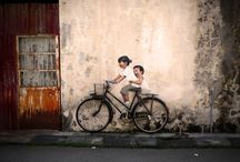 Ernest Zacharevic / Ernest Zacharevic is a young Lithuania-born artist who is setting his art in George Town, Penang, through impressing wall paintings and murals at selected streets in the inner city. The project, known as Mirrors George Town, is part of George Town Festival 2012.