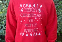 Ugly Christmas Sweaters / by Emily Mitchell Swinyer