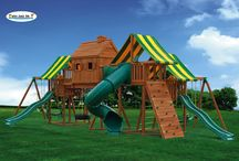 Imagination Swing Sets / The Fantasy Tree Swing Set is amazing! Remember when you were young and had your own tree house? That place you could call your own and get away from it all. Now you don't have to build one for your kids, we've done the work for you! Our Fantasy Tree House #1 starts with the 5' clubhouse with a 10' wave slide and steel rung access ladder. Our exclusive bridge connector to a 7' high Tree House incorporates Double Wide Monkey Bars underneath the tree house and bridge connector!.