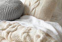 almohadones y mantas tejidas