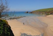 Trevone Bay Nr Padstow Cornwall / Trevone is a great community with a local store, surf shop, cafe – and most importantly, two fantastic beaches – one large and sandy, and one rocky. The main sandy cove stretches back to the beach car park and has the added attraction of lifeguards during the summer months, offering greater security.  You can hire surfboards and wetsuits at Trevone at the big beach shop. Many consider Trevone a perfect Cornwall beach