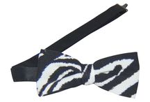 """Theme Bow Ties / Six Star Uniforms character print banded bow ties measure approximately 4"""" across and 2"""" high on the ends. Adjustable band to fit all neck sizes. Matching vests are available / by Six Star Uniforms"""