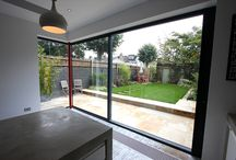 Project: Lynton Road / Slim framed sliding glass doors create a modern rear face to a traditional home.