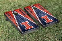 "Big 10 Gamedays | Victory Tailgate / Our officially licensed collegiate cornhole games are made proudly in the USA. Each game set comes with two 24""x48"" regulation boards with folding legs, a complete bag set (8 bags), and a FREE string pack to carry the bags (A $10 value!)."