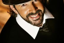 Juan Luis Guerra loves hats