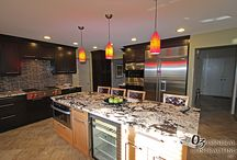 Modern Kitchen with Flare / This is an example of a kitchen we've done in the past with a modern flare. The backsplash works perfectly with the countertops and cabinet color. The lighting above the island is a great way to add color to a space and give a dramatic affect.