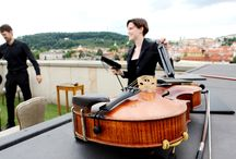 Summer Concerts at Four Seasons Hotel Prague 5th Floor Terrace / A light classical music performance with a String Trio, taking place on our 5th floor terrace, and offering amazing views of Prague Castle, Charles Bridge, Lesser Town and Vltava River