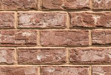 Santa Fe   Triangle Brick Company / Give your project a taste of the Southwest with Triangle Brick Company's Santa Fe brick. As one of our most unique exterior cladding options, the Santa Fe brick makes a statement with a textured, terracotta-colored base and soft paprika, sand and dark gray accents evoking the soft colors of a Pueblo-style abode. This tumble washed brick is classified under our exclusive Select tier for a high-quality product that exceeds the competition in every way.