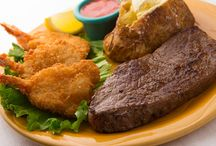 Steak Dinners / 7 oz. Sirloin Steak entrées served with a cup of soup, made from scratch or a Kings house salad, vegetable and choice of baked potato, French fries or mashed potatoes.
