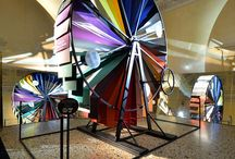 Exhibition Alcantara 2015 / The construction of elaborate stage machinery used during festivities was typical of the royal courts of the past. This wheel refreshes history with a great instrument that is a symphony of unusually beautiful colours, textures and sounds. A hall of mirrors hints at the endless variations on a theme that only a material like Alcantara can provide.
