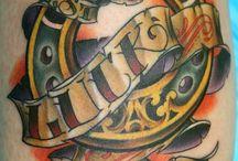 Tattoos / by Quinn Tolbert