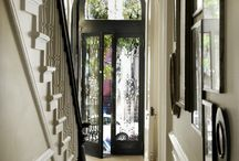 I love these entryways color schemes. Dark paint color on doors I love the wall color.  Very majestic.