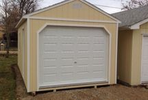 Portable Garages / Specializing in building Portable Garages for home owners and business alike. We offer Garages with electrical packages and work benches fitted to your specs.   With a fast turn around time of Order, Build, & Delivery averaging 3 weeks +/- it makes it one of the easiest ways to get a Garage that's built like a home. With wall & rafter framing 16'' and floor joists 12'' topped with 3/4'' plywood you can't go wrong in purchasing, Rent to Owning, or financing one of our Garages!