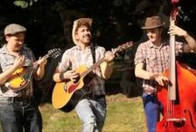 FEATURED: The Hill Valley Joes / The Hill Valley Joes are a London-based acoustic trio of musicians playing pop songs with a bluegrass/country twang. Covering artists from Pharrell to Jeff Buckley, this quirky act are perfect for providing fun background music at weddings, picnics or any event with country styling.  As well as being available as a trio, the band can also add drums and can add amplification for larger audiences or if you would like to encourage dancing.