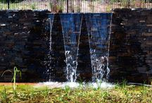 Feature Project | Natural Billabong / Eckersley Garden Architecture has designed a natural swimming pool which uses marine biology as purifiers. The natural pool has used Myrtle split stone which complements the rugged bush surrounds and flows seamlessly from external to internal areas. The retaining walls are clad in Badger dry stone walling which blends beautifully with the surrounding plants.