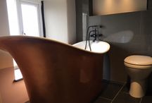 Contemporary Bathrooms with Slate Bath Surrounds and Tiles / Contemporary and modern bathrooms with slate cladding, wall tiles and flooring around a range of baths including roll top and sunkens bath tubs.
