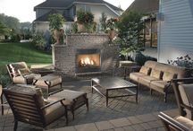 CALGARY BACKYARD FIREPLACE / Fireplace design from Calgary landscaping company creates a wonderful way to put your special impression on your outdoor landscape. Keeping warm is a logical step in building that dream backyard.