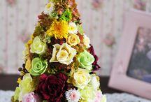 イエロー・オレンジ・グリーン プリザーブドフラワーアレンジメント / プリザーブドフラワー&アートフラワーの専門店「Ayanasu花工房」のオレンジ・イエロー・グリーン系の色でつくられたフレッシュで爽やかなプリザーブドフラワーアレンジメント。
