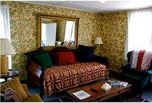 "Room Five - The Old Village Inn / Room five is located on the third level of our establishment and is considered a ""two-room"" suite.   Bedroom w/Queen Bed Living Room"