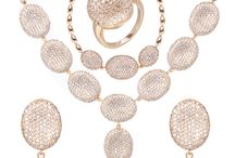 JEWELRY SET-TZXG0089 / Item Specifics: 1. Produce material: brass 2. Stone: CZ Zicron 3. Plating: 18K 4. Necklace length: 50cm 5. Pendent size: 60.8*22mm 6. Weight: 46g 7. Earring size: 38.8*17.5mm 8. Weight: 10.3g 9. Bracelet length: 22cm 10. Weight: 14.3g 11. Ring size: #6-#10 12. Weight: 5.4g 13. Total weight: 76g 14. Plating option: 14K/18K/20k/22k/24k/rose gold/rhodium etc