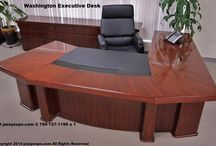 CEO Desk - Washington Model / A large desk designed for executives for a prominent appearance in a CEO's office. This professional wood desk has a workstation on the main desktop and on the side return top.to work either way. Video monitors placed on the side return top won't block the view of people seated in front of your large executive desk. This CEO desk is in stock in all 4 sizes with left or right side returns. Includes 2 computer data port.