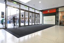 Poole Dolphin Shopping Centre - Entrance Matting / The Dolphin Shopping Centre in Poole, Dorset, needed new entrance matting to handle the high volume of shoppers that visit the retailers and stores there. We fit our commercial flooring solutions globally. However, this project was just a short drive from our headquarters outside Bournemouth.