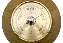 Timber-Treasures Peasedown St John Barometer (21cm) / This Timber-Treasures, quality brass barometer is set in a hand turned frame of Elm from Peasedown St John, Somerset (UK). Using air pressures it is able to predict the weather with its quality German mechanism. The wood frame measuring 21cm, was recovered from an Elm tree felled in 2007 in Peasedown St John to allow more light and air to the trees around it in a previously untended area of local woodland.