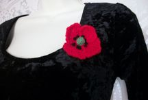 Hand Knitted Poppies / Poppy brooches, hair slides and hats. All hand knit and stitched.