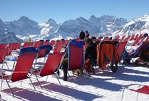 Männlichen, Switzerland / Between Gridelwald and Wengen in the Jungfrau region of Switzerland - Männlichen is a sun drenched terrace overlooked by the might Jungfrau, Eiger and Munch mountains and a party zone for skiers, sledders, walkers and everyone