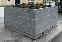 Granite Tree Planters / Large 2 x 2 x 1.3m planters clad in granite tiles. iThe panter is engineered so it is possible to move the planters, even when fully planted.