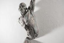 half wall sculpture