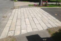 Reclaimed Granite Curbing Used in Driveway Aprons and Wakways. / Use reclaimed granite curbing in driveway aprons, edging, walkways, etc.