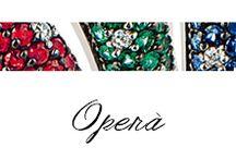 Operà / Anelli in oro bianco e rosa, diamanti, diamanti black, zaffiri, rubini e smeraldi.