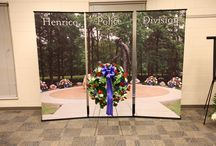National Police Week 2016 / The Henrico County Police Division honors all fallen officers each year during National Police Week. In particular, it pays tribute to its own fallen officers. Sometimes the weather does not cooperate, so the ceremony is held indoors as it was in 2016. Flowers are moved to the Police Memorial Park when the weather clears.