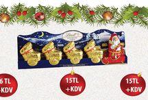 Yeni Yıl Çikolatası - Yılbaşı Hediyesi / Yeni yıla özel yılbaşı çikolatalarını hediye sepetinize ekleyin. Rengarenk ve lezzetli Lindt Çikolatalardan oluşan noel baba, geyikler, ayı teddy ile çikolata sepetinize anlam katın.