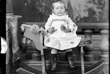 Children on rocking horses / All these photos were taken at William James Harding photography studio in Whanganui, in New Zealand's North Island. The same two rocking horses appear in all the photos - it's the solemn, occasionally lumpen children who change out. I'm also starting to think that Harding had a beret and a boater that he used as props - if they're not on the kids' heads, they get draped over the rocking horses' ... whatever the thing at the bottom of a rocking horse is called.