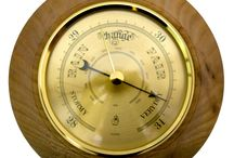 Timber-Treasures Peasedown St John Barometer (13cm) / This Timber-Treasures, quality brass barometer is set in a hand turned frame of Elm from Peasedown St John, Somerset (UK). Using air pressures it is able to predict the weather with its quality German mechanism. The wood frame measuring 13cm, was recovered from an Elm tree felled in 2007 in Peasedown St John to allow more light and air to the trees around it in a previously untended area of local woodland.