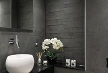 Guest Bathroom / Feature funky bathroom - wall paper  Floating counter  Small cupboard  Floating shelf Round mirror  Tiled floor