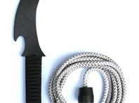 """Shinobi Gear - Kusari Tanto / """"Hand made High-Impact Delrin Plastic Kusari Tanto"""". Why settle for ordinary poly-propylene plastic when you can train with a superior form of high-impact plastic. Our hand made kusari tanto features a cord wrapped handle, 10 foot of soft/durable rope attached to a rubber weight, curved blade with hook, & beveled edges for a realistic look."""