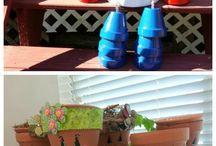 vasos pintados com cara de criança.