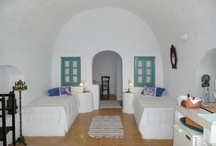 Apartment Xenia - Hospitality / Apartment for up to 4 people consisting of living room with two single bricked beds  0,90 x 2,00m and  bedroom with bricked double bed  1,40 x 2,00m separated by a door arch and windows in the traditional island style. Kitchenette in the living room, shower/toilet.  Living space 350 sq.ft., private, furnished terrace 95 sq. ft. / by Aris Caves