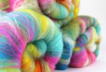 Spin City /  Louise's Spin City is a treasure trove of sparkly, fluffy delights - with a myriad of rainbow dyed natural fibres collected from local English farms - which Louise combines with luxurious ingredients such as faux cashmere, soya silk, firestar, tencel and her personal favourite - glitter!