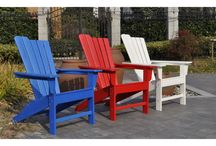 Panama Jack Outdoor Adirondack Collections / Adirondack chairs in 3 primary colors with matching ottomans and end tables