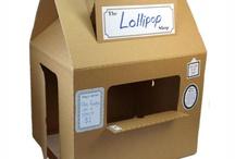 Дети: Дома, магазины из картона.