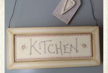 Kitchen and Dining / At Home with Molly and Me are proud to share our Kitchen and Dining range, including some of the latest designs from Gisela Graham and Heaven Sends.  We have hand-picked many items including ceramic pots, perfect for herbs on the kitchen windowsill, wall signs with meaningful kitchen sentiments and a range of useful items such as spoon rests, wooden and wicker trays, napkin holders, trivets and egg baskets.
