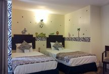 Family Suite- Safari themed sleeping area / 4 adults, 2 children maximum - 2 double, 2 single beds Partial ocean-view guestroom.