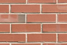 Flashed Common   Triangle Brick Company / Perfect for both residential and commercial building applications, Triangle Brick Company's Flashed Common brick delivers tasteful, timeless style to homes and businesses alike. Our flashing process gives this classic red architectural brick a smooth finish and subtle variations in color ranging from white to soft gray to charcoal. Building with Standard-tier Flashed Common brick creates a subdued backdrop for your property that complements a variety of architectural styles.