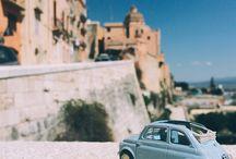 #500insardinia / Prendi una #Fiat500 in miniatura, portala in giro per la #Sardegna, parcheggiala davanti a uno dei suoi luoghi simbolo e scatta. Tag #500insardinia  #Saridnia as seen from the perspective of a mini Fiat500